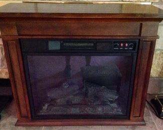 Electric Fire Place.  It can stand alone, be used as a TV Console, or be used as an insert for a fireplace.