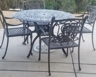 Contemporary patio set Gray powder coated metal round patio and 4 metal arm chairs
