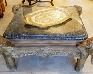 Cocktail table beveled variegated black marble inset top large carved Indian elephant head corners