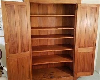Shaker-style cupboard shown open