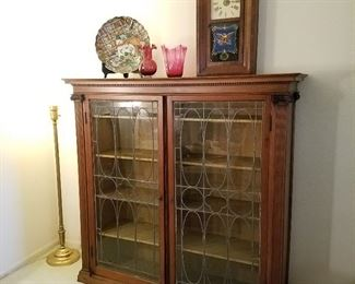Leaded door bookcase from the former Savidge/Loutit home in Spring Lake. Clock is a 30 hour Waterbury.