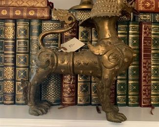 #9 brass foo dog with leather bound books