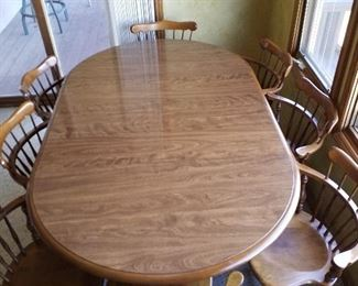 Dining room table with 8 chairs and 2 leaves