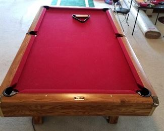 Brunswick pool table with baals, rack and extra pool sticks