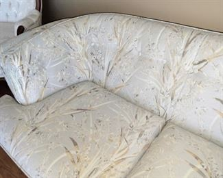 """Rounded """"club chair"""" style sofa, tufted back and sides, pale gray fabric with tan and brown foliage.  High quality, by Berne Furniture.  84"""" wide."""