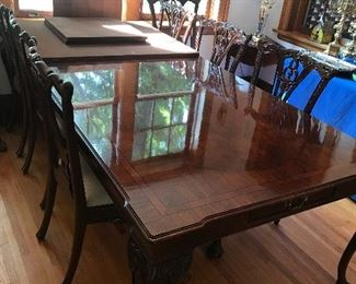 Gorgeous dining room table w/extra leaf, 10 chairs, and cover pads.  Absolutely STUNNING!!!