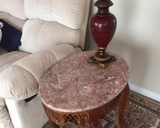 one of several marble top tables with carved wood