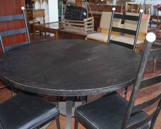 round black table with 4 chairs