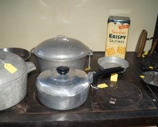 vintage Krispy Kracker tin, pots and pans, cast iron corn bread pan, trivets