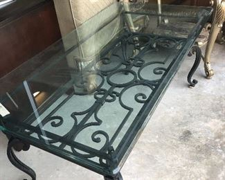 heavy wrought iron and glass table  good quality
