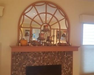 Above fireplace arch mirror with decorative items