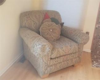 Family room chair that has a matching ottoman