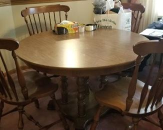 Table and chairs with 2 leaves $168