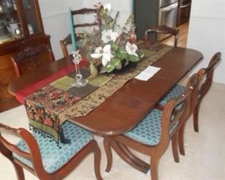 Smaller scale table and chairs. Yet, additional  leaves offer dining for a larger group with ease.