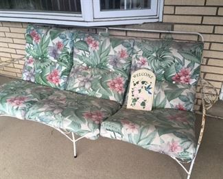 This is the sofa/love seat match to the wrought-iron set.