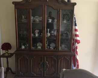 . . . this is a nice formal china cabinet perfect for storing your treasures.  This one has an assortment of vintage cups and saucers, vase, and other neat items.