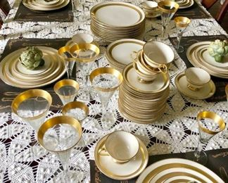 Flintridge China, Theme pattern, service for 12 plus, wide gold rim, dinner plate, salad plate, bread and butter plate, cup and saucer, 24Kt gold rim stemware, wine glasses, cordial glasses