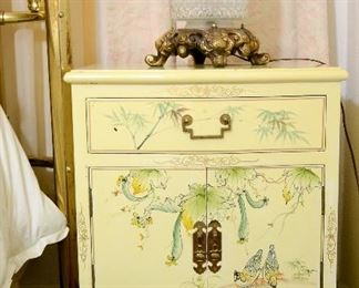 Oriental night tables to match the dresser.
