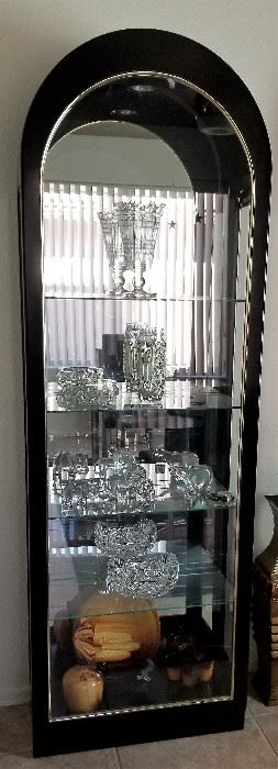 Lighted curio cabinet with mirrored back.