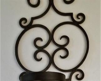 Wall metal candle holders.