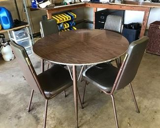 #27 Vintage Table Set with One Leaf and Four Chairs $20 Chairs need to be recovered. The set is sturdy.