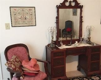 Antique Rocker, Antique Vanity with Mirror, Antique Lamps, Antique Needlepoint Sampler.