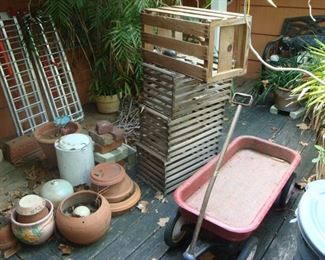 Vintage chicken crates, children's metal wagon, clay and terracotta pots, live bamboo.