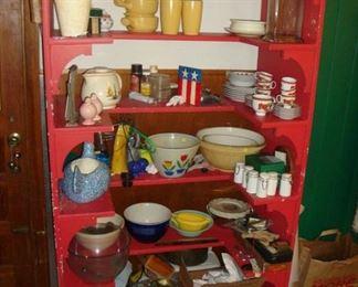 U-shaped shelving with kitchen bowls.