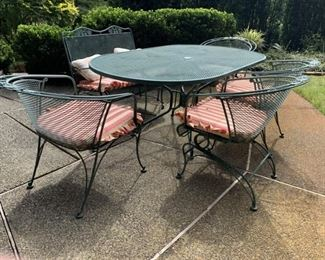 Wrought iron oval table 4 chairs and love seat glider.
