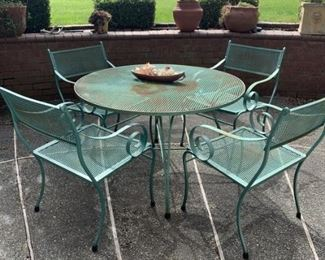 Wrought iron round table and 4 chairs