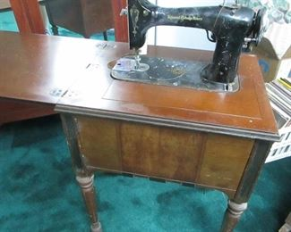 vintage electric sewing machine in cabinet