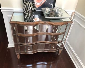 mirrored  serpentine front dresser