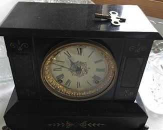 Mantle/tabletop clock with key