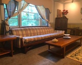 Lookit the teakwood frame on that sofa! Perfect condition MCM sofa, buy it and be the envy of your friend(s)!