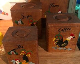 vintage kitchen canisters made of wood depicting a rooster in various yoga poses