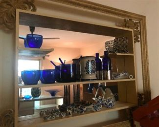 Lots of blue glass and blue-and-white ceramics Chinoiserie, Portofino, are those Dutch wooden shoes made of ceramic? Don't walk on asphalt with those on