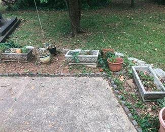 3 small cement caskets