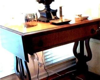Antique tiger maple Library style table with drop leafs & harp sides
