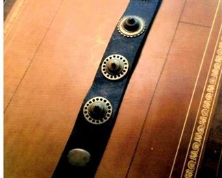 Vintage Leather belt with brass horse medallions affixed thereto
