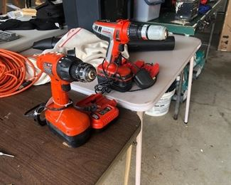 Black and Decker cordless drill with batteries and chargers
