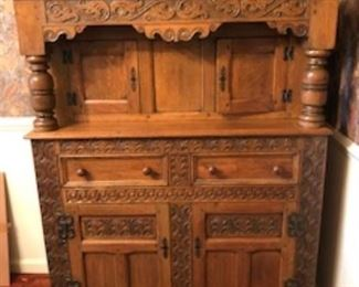 Beautiful ornate cabinet....yes, it is even more beautiful in person!