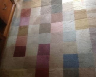 Multi colored rug measures 6 x 9