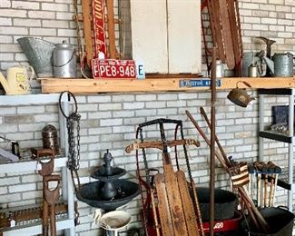 Lots of antiques, farmhouse pieces, shabby chic, old sleds