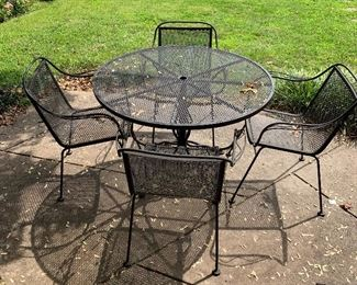 Outdoor seating; includes 4 chairs plus table. Nicely scaled set for a petite patio