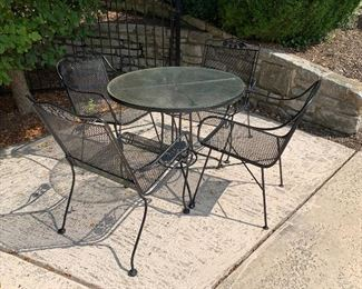 Outdoor patio set with 4 chairs and round glass top table