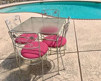 Simple makes fun with this square wrought iron glass top table with 4 chairs. So sweet!