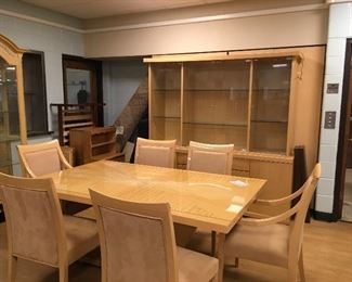 High end designer Italian made Dining Room set.  Table, 6 chairs, buffet and hutch with glass doors. Light maple wood.