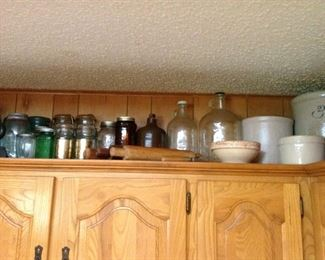 Lots of old canning jars, jugs, crocks, hand made rolling pins, etc.