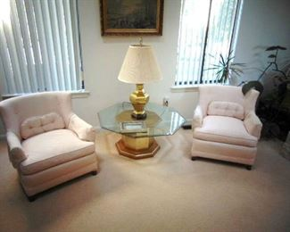 Pair of upholstered arm chairs (sold as a pair), brass table base with octagonal, beveled glass top and a brass lamp