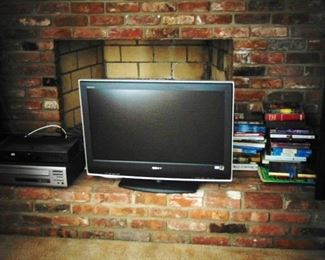 Sony flat screen TV with books in the background